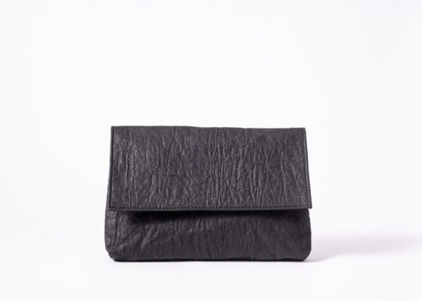 Front view on an upstanding charcoal colored Pinatex Clutch with invisible magnet opening