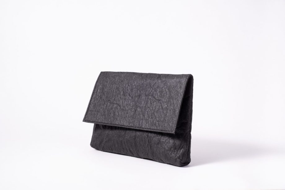 Front side view on an upstanding charcoal colored Pinatex Clutch with invisible magnet opening