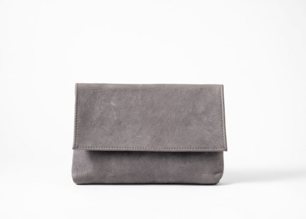 Front view on an upstanding blue-greyish vegetable tanned Leather Clutch with invisible magnet opening