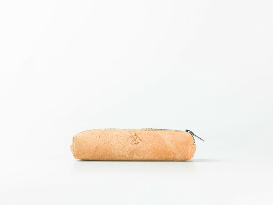 Lateral view on a light natural patterned cork pencilcase with a silver zip opening