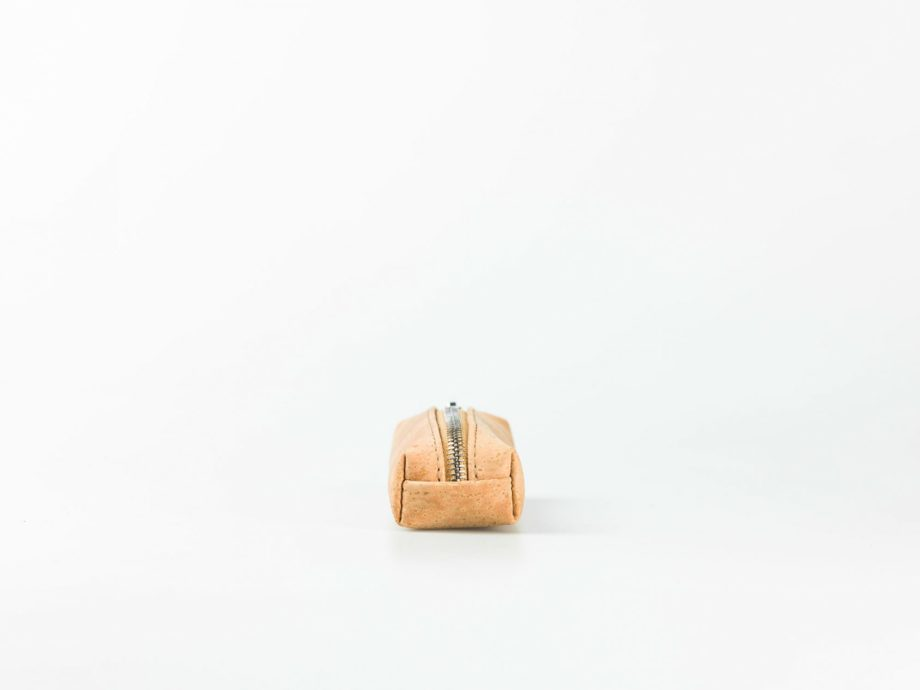 Front view on a light natural patterned cork pencilcase with a silver zip opening