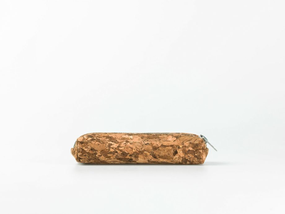Lateral view on a dark patched patterned cork pencilcase with a silver zip opening