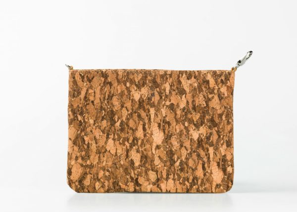 standing up cork pouch in a dark patched pattern, with a hook on one side and a small D-Ring on the other side.